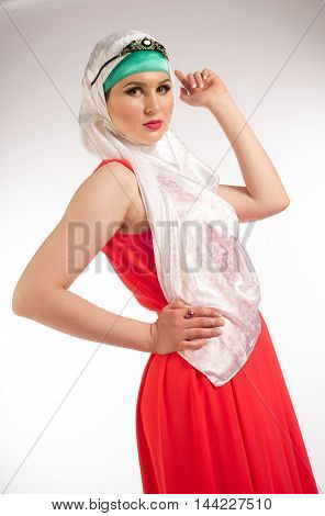 Muslim Beautiful Girl In The Red Dress And The Hijab
