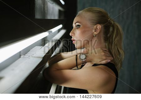 portrait of a beautiful girl against the wall