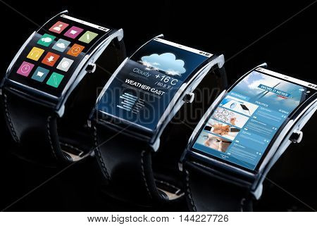 modern technology, object and media concept - close up of black smart watch set with weather cast, business news and menu icons