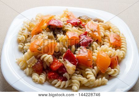 Italian Pasta Fusilli With Vegetable Sauce Of Peppers Closeup