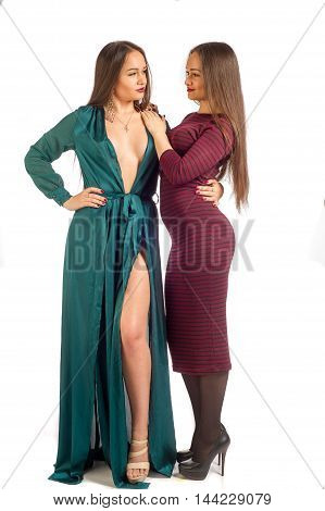 Pretty Girls. Contrast, Modest And Sexuality. Modest Girl, Sexy Dress Standing In The Open. Sisters