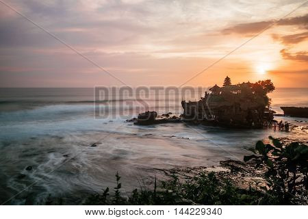 Tender sea view sunset near Tanah Lot temple , Bali.