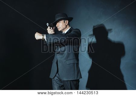 Vintage Film Noir 1940S Gangster Shooting With Gun.