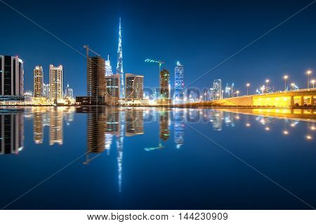 Fascinating Reflection Of Tallest Skyscrapers In Business Bay District During Calm Night. Downtown S
