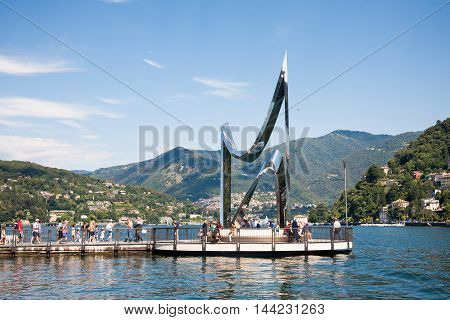 Como Italy - 2016 August 18 : The Life Electric is a stainless steel sculpture created by Daniel Libeskind as a homage to Alessandro Volta and is installed on a jetty on the Como Lake in the city of Como