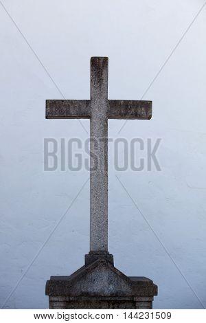 Grey stone cross on the Spanish coast