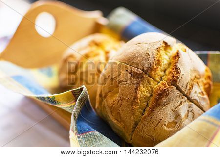 Freshly Baked Traditional Corn Bread in Wooden Basket. Fresh Corn Buns Closeup Selective Focus.