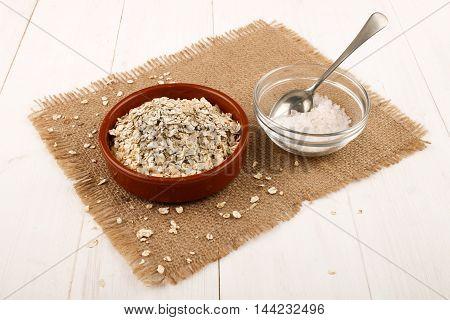 irish steel cut oats in a brown bowl and coarse salt on jute