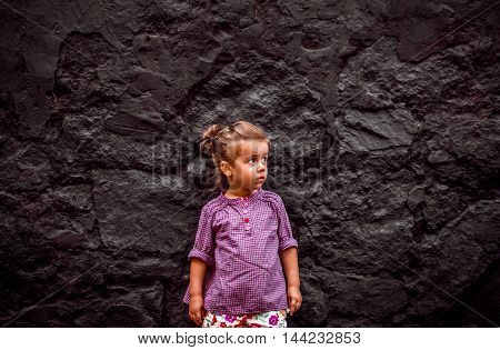 Emotion Girl Sitting Near Wall In The Day Time