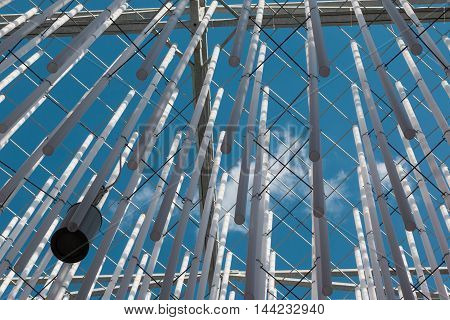 MILANO, ITALY - MAY 2015: Hanging Plastic Pipe and Blue Sky in Background Modern Architectural Design Theme at Milan Exposition 2015 - Italy