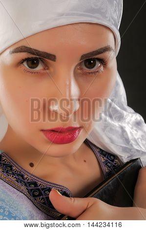 Beautiful Girl, A Muslim. Wearing A Hijab. Holding The Koran