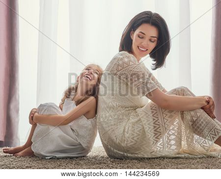 Happy loving family. Mother and her daughter child girl playing