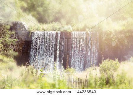 Blurred Waterfall. Beautiful waterfall landscape. Waterfall in forest.