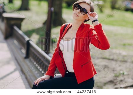 spectacular young brunette outside fashionable and healthy