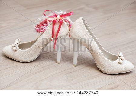 Stylish white female wedding footwear. Bridal shoes, close-up