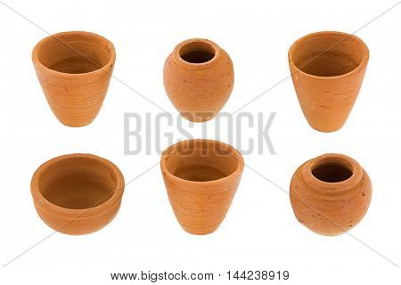 Handmade small round unglazed clay pots in different size, type, shape isolated on white background