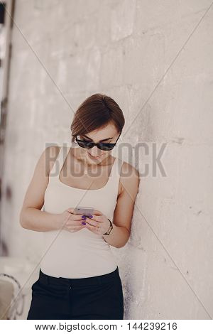 beautiful girl in cafe using cell phones