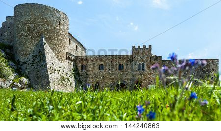 chart of the Bovino Castle province of Foggia seen with low angle to the level lawn in front. Southern Italy