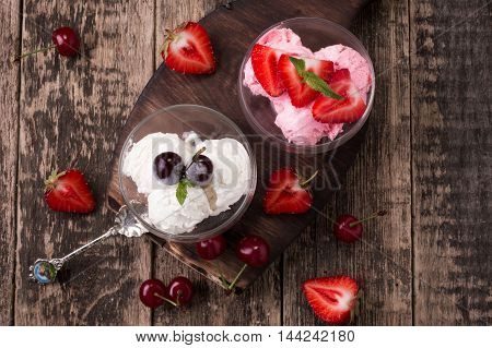 Delicious Bowls Of Strawberry And Vanilla Ice Cream With Mint