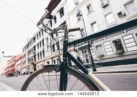 around the city by bike, standing in the street