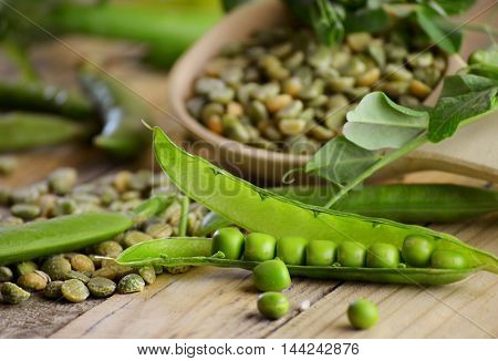young green peas in pods and dry grains