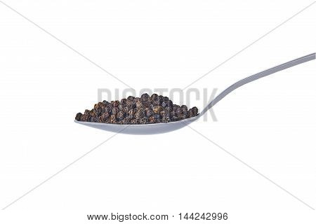 spoon with a bunch of black pepper on a white background isolated