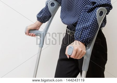 Closeup woman with crutches walk rehabilitation,physical therapy