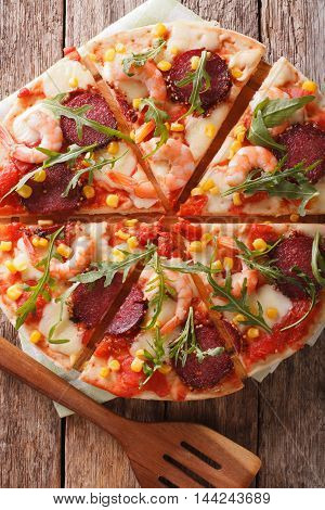 Sliced Pizza With Shrimp, Salami, Cheese And Arugula Closeup. Vertical Top View