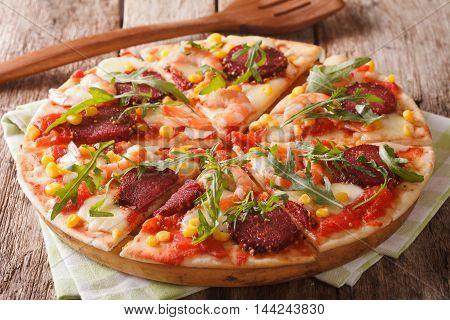 Italian Pizza With Salami, Shrimp, Corn, Mozzarella And Arugula Close-up. Horizontal