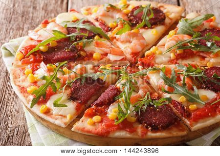 Hot Pizza With Shrimp, Salami, Cheese And Arugula Close-up On A Wooden. Horizontal