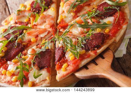 Pizza With Shrimp, Salami, Cheese And Arugula Macro On A Board. Horizontal
