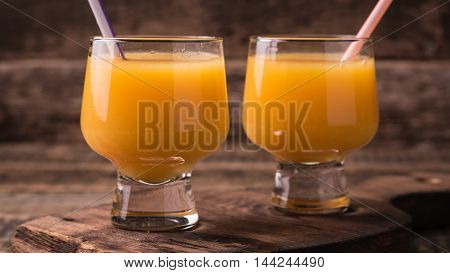 Citrus Juice And Fruits On Wooden Background.