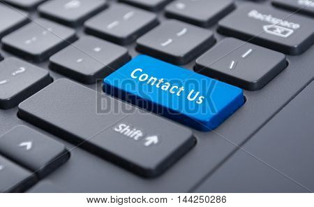 Blue Contact Us Button On Black Keyboard Concept