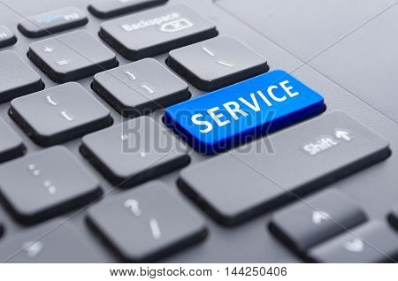 Blue Service Button On Black Keyboard Concept
