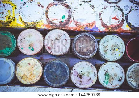 Gouache paint jars. Tools for creative work. Back to school. Paintings Art Concept. Top view.