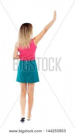 Back view of beautiful woman welcomes. Young teenager girl in jeans hand waving from. Rear view  people collection.  backside view of person.  Isolated over white background. Blonde in a red sweater