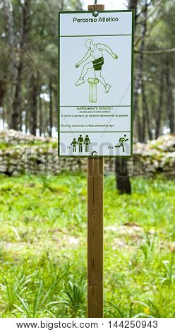 Fitness training in forest. Sign planted in a forest that indicates