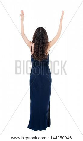 Back view of beautiful woman welcomes. Young teenager girl in jeans hand waving from. Rear view  people collection.  backside view of person.  Isolated over white background. The dark curly girl in