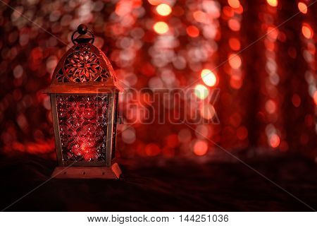 Eid or Ramadan Greetings card with glittery background and a lamp