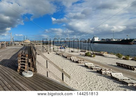 beach at Aarhus in Denmark, harbor in the background