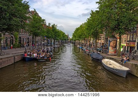 AMSTERDAM - CIRCA JUNE 2014: Historical center of Amsterdam. More than four million tourists visit this city every year.