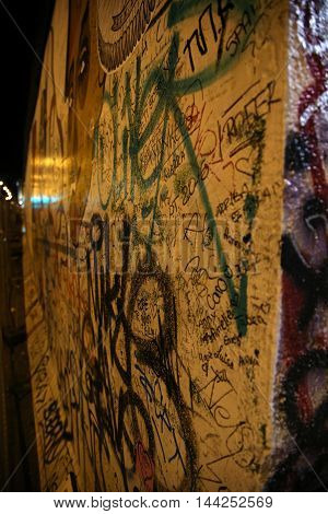 BERLIN GERMANY - AUGUST 23 2016: Artistic graffiti paintings on the Berlin Wall at the east side gallery of the Berlin Wall near the river Spree. Berlin is capital of the Germany on August 23 2016.