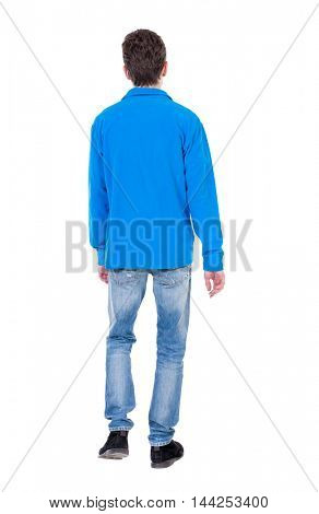 Back view of going  handsome man. walking young guy . Rear view people collection.  backside view of person.  Isolated over white background. Curly boy in a warm blue sweater goes out of frame.