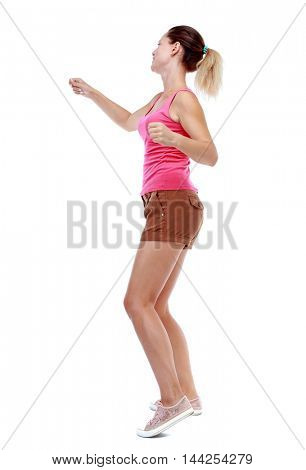 back view of woman funny fights waving his arms and legs. Isolated over white background. Sport blond in brown shorts boxing.