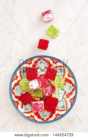 Delicious Turkish delights on white marble background
