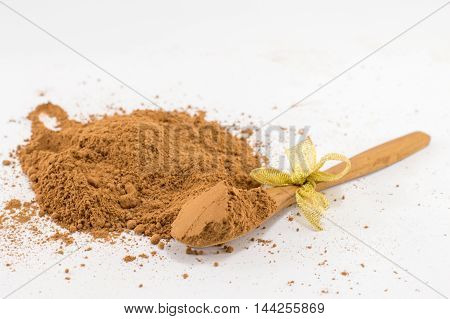 Bunch Of Cinnamon On White Kitchen Table