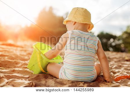 Baby boy playing with beach toys,close up