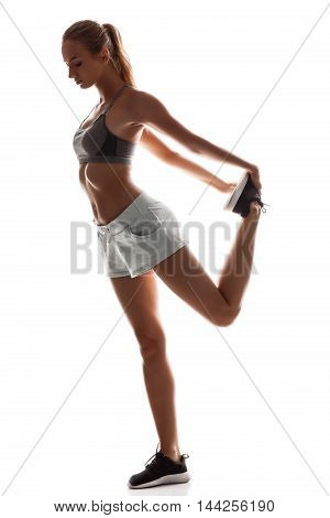 Young beautiful sportive girl training over white background. Copy space.