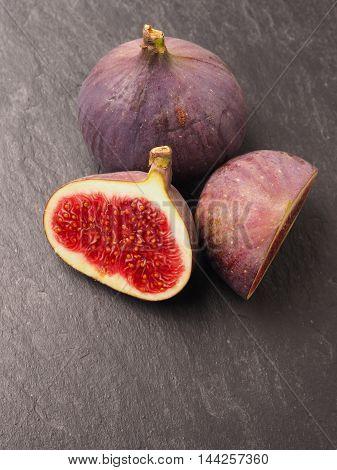 Fresh organic figs on a dark slate background healthy food