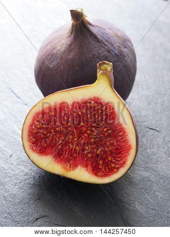 Fresh organic figs on a dark slate background closeup shot